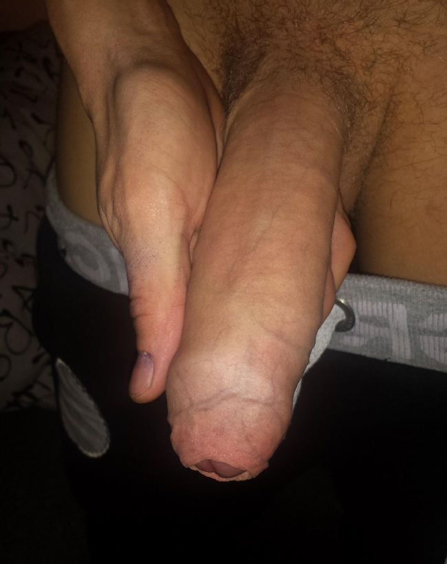 Guy holding his huge dick